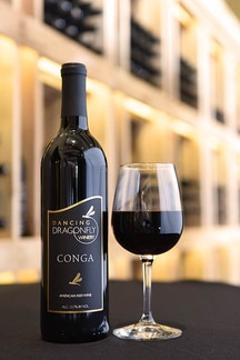 Picture of a bottle and a glass of Conga